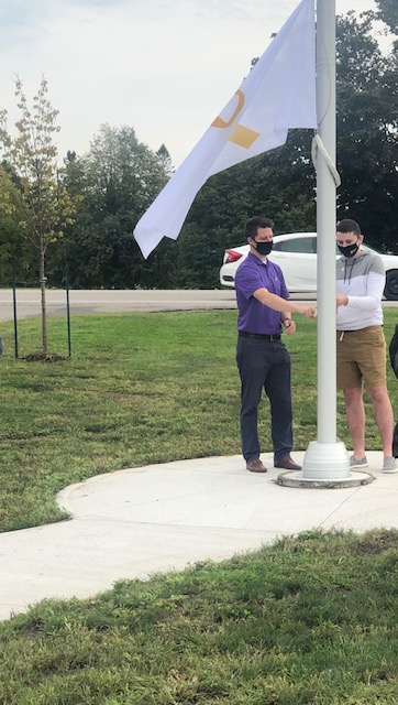 Jack Hildebrand raising the child cancer flag