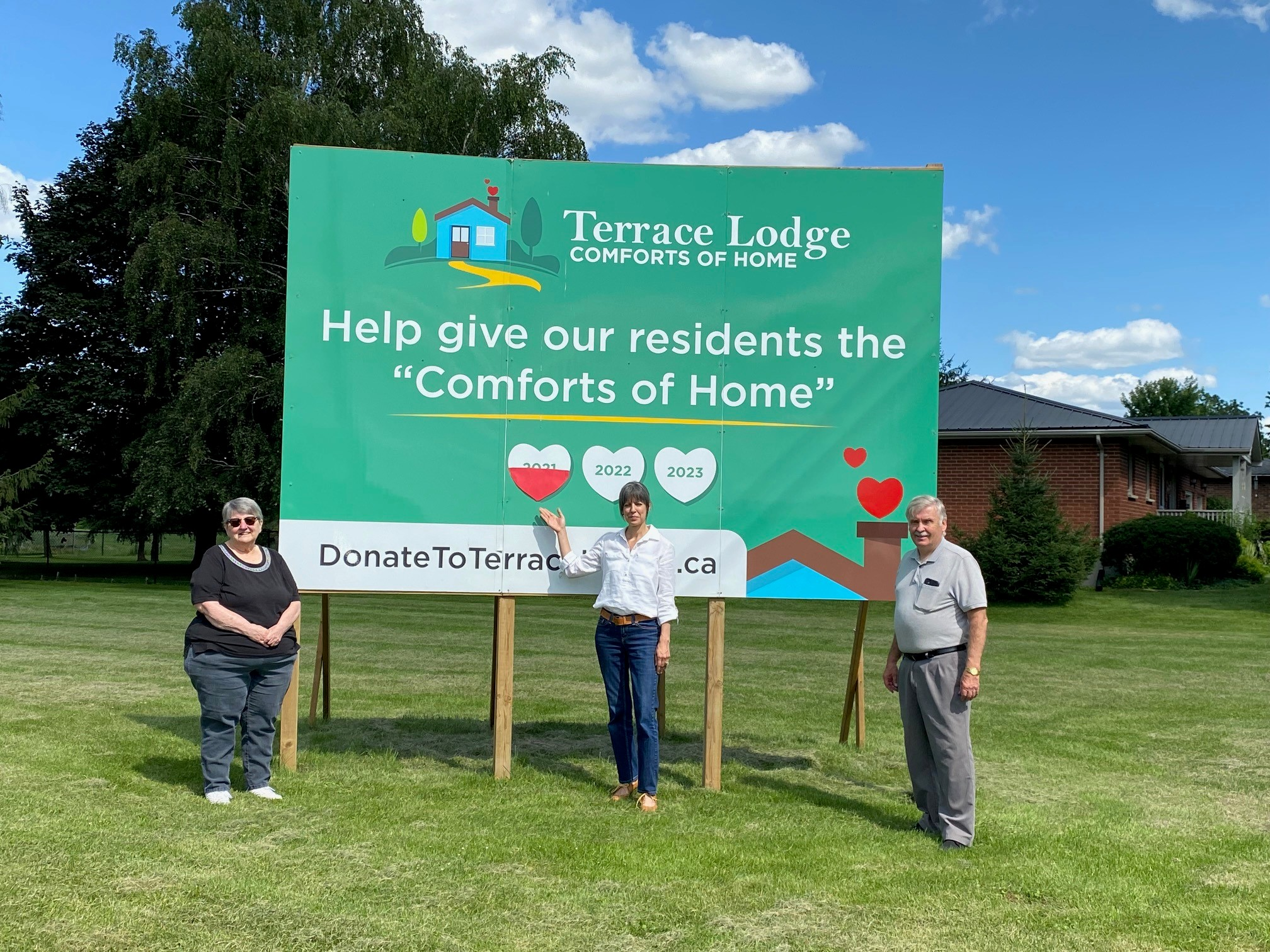 Terrace Lodge Committee at Fundraising Sign