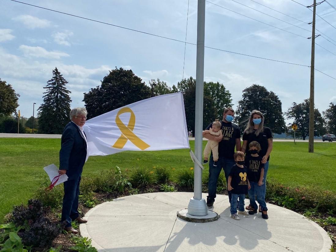 Flag Raising for Childhood Cancer Awareness Month